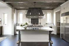 Linda McDougald Design - kitchens - brick, ceiling, wood beams, range hood, forged iron straps, glossy, subway tiles, backsplash, white, kitchen cabinets, marble, countertops, kitchen island, beveled, butcher block, countertops, pot filler,