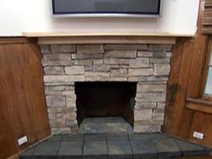 Learn from HGTV how to easily remodel a brick fireplace by refacing it with stone.