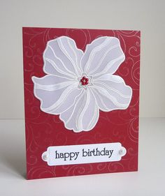white vellum flower on a red card stamped with silver flourishes...clean and simple...