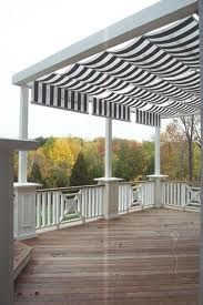 I love how the fabric softens an otherwise plain pergola