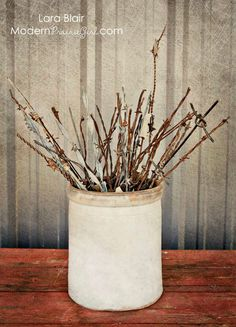 barbed wire bouquet/ this would be cool in a larger scale!  And on a porch