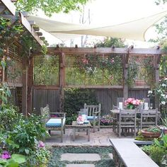 Create privacy with freestanding trellis to screen without violating fence height codes.