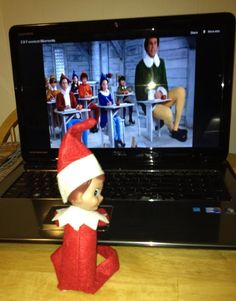 Day 8 - Watching the movie Elf (see idea on my board for how to have him sitting)