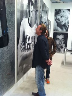 Julian Lennon looking at a photo of his dad