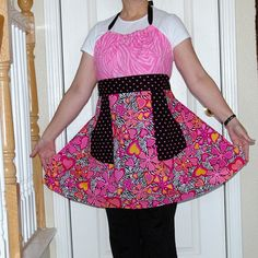 1970s retro look apron has a halter-style neck, 2 generous pockets and 3 fun prints that make a terrific apron. Pink zebra print is used on