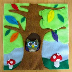 Forest Scene Felt Quiet Book page with removable owl and bird in nest hiding under some leaves.  Tutorial and pattern included!