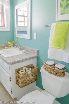 Love this bathroom makeover + hanging basket for toilet paper!