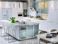 Kitchens with white cabinets and black appliances4