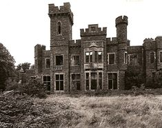 GWYNFRYN PLAS, Llanystumdwy, Caernarvonshire, Wales. The house is positioned beautifully on the Lleyn Peninsula overlooking Snowdonia and Cardigan Bay. Looking up at the house it became quickly apparent that the larger tower is nearing the precipice of collapse.