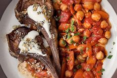 Splurge on lamb rib chops or save on loin chops; either way you will enjoy this Moroccan-inspired meal. The familiar flavors of an everything bagel make a surprise appearance here to spice a zesty yogurt dip. Harissa paste (available in specialty food stores and many grocery stores) adds a fiery punch to chickpeas simmered with carrots and tomatoes. It can vary greatly in spiciness and saltiness from brand to brand, so add a little at first and taste as you go.