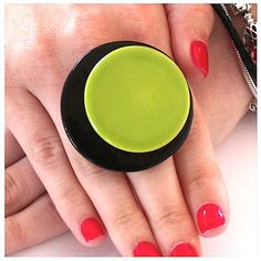 Oversized ring Can be worn with matching garments Greens and blacks