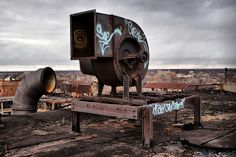 {I love the emphasis this photographer places on the subject by how he has edited and enriched the color in this photo}.  Packard Rooftop Contraption #1 Detroit 11/08 by Detroit Liger, via Flickr