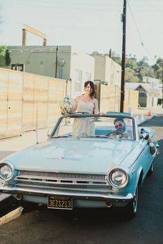 baby blue vintage getaway car #newlyweds #getawaycar #weddingchicks http://www.weddingchicks.com/2014/04/14/vintage-eclectic-california-wedding/