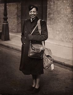 Josephine Baker in the uniform of the Women's Auxiliary of the Free French Air Force. By the autumn of 1944 she had raised 3,143,000F for the French war effort and was awarded the honorary rank of sub-lieutenant in the Ladies Auxiliary of the Free French Air Force, Les Filles De L'Air. She gained her pilot license in 1933! Photographed at the Savoy Hotel, London April 1945 ~