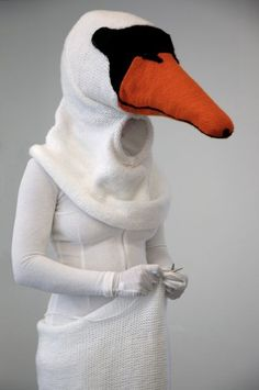 Zwaanshals (swan neck), 2008  Knitted costume of wool, polyester and felt. Video: Anneke de Boer
