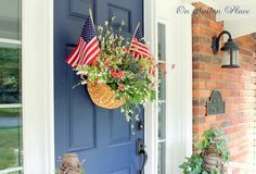 Plant flags in a basket overflowing with blooms that nearly mimic fireworks for a cheerful and patriotic way to decorate your door.