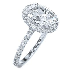 Cathedral Oval Diamond Ring with a Diamond Frame