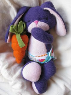 Tiny Baby Bunny PDF Sewing Pattern.  12 Weighted Bunny Sewing Pattern Includes patterns for a diaper and little carrot plush.  Material & Equipment Requirements: *Access to a Printer *Sewing Machine *General Sewing Sundries:  Thread, Scissors, Pins, Washable Marking Device & Awl *Chopstick (clean please) or another sturdy stick for stuffing *1/3 yard of Fleece, Craft Velour or Suede Cloth *PolyFill (amounts vary so its better to get a big bag) *PolyBeads *Embroidery Floss *Hand Sewing…