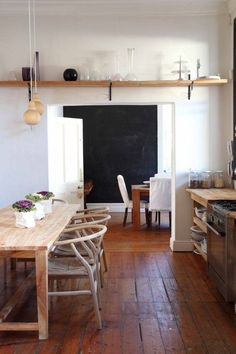 wooden table and wishbone chairs rustic kitchen