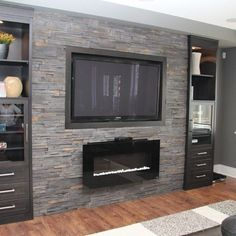 Basement Family Room Design Ideas, gas fireplace with wall mount TV on grey stone feature wall by Kim Hill lkW3d