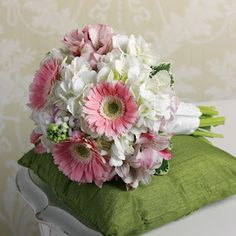 Bridal bouquet of soft pink gerbera daisies nestled in a blanket of white hydrangeas.