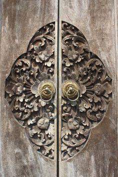 Detail of carved wooden door, Bali//