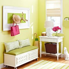 Furnish an Entry:Primer, two coats of white paint, a simple cushion, and new casters complete the exterior overhaul. For functional art above, paint an old frame to match the chest, insert a wallpaper sample, and secure branches with heavy-duty glue to create a hat rack.
