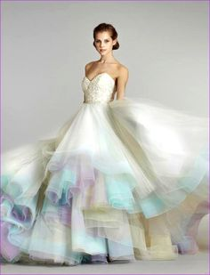 This wedding gown does not have much purple in it but one could easily adapt this to a wedding party with mauve, blue, pink bridesmaids in pretty pastels.