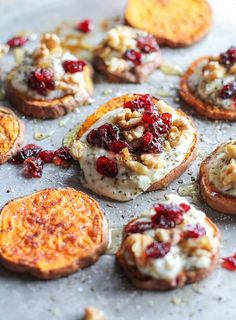 Sweet Potato Rounds with Herbed Goat Cheese, Roasted Walnuts, Cranberries, and Honey | http://TheRoastedRoot.net an easy and healthy appetizer! #recipe #glutenfree #healthy #holiday