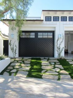 Beautiful garage doors and a really artistic driveway! 11 Ways to Make a Cookie-Cutter Suburban House Stand Out | Apartment Therapy