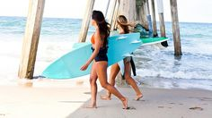 """Nothing says <a href=""""http://www.travelchannel.com/interests/beaches/articles/top-10-southern-california-beaches"""">California</a>  more than the beach. Female surfers carry the ultimate beach accessory –surfboards – in Hermosa Beach, CA."""