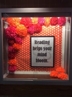 """Reading helps your mind bloom."" library display"