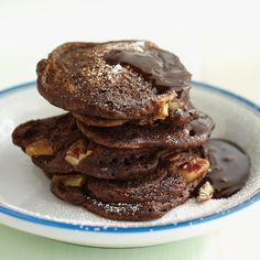 Surprise everyone at the dinner table with a stack of fluffy chocolate pancakes; they're especially good drizzled with hot fudge sauce.