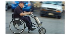 Wheelchair accessory helps people get up hills and around town fast. Go fast with Firefly power handcycle