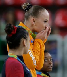 Netherlands' Sanne Wevers kisses her gold medal for balance beam during the…