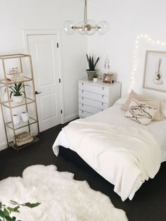 Beautiful, white bedroom design with minimalist shelves