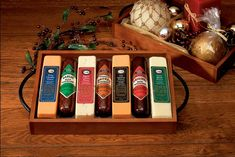 This gift features a hardwood serving tray with metal handles and contains three varieties of all~beef sausage and four of our finest gourmet cheese bars.