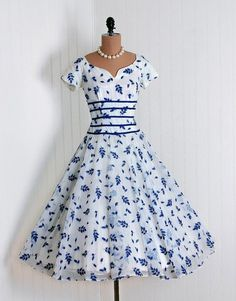 Vintage blue and white patterned party dress with sweetheart neckline, Liesl ribbon trim, cap sleeves, and full skirt.