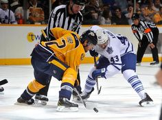 TORONTO MAPLE LEAFS VS. NASHVILLE PREDATORS NASHVILLE, TN - OCTOBER 10: Mike Fisher #12 of the Nashville Predators takes a faceoff against Nazem Kadri #43 of the Toronto Maple Leafs at Bridgestone Arena on October 10, 2013 in Nashville, Tennessee.
