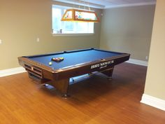 You can never go wrong with a Brunswick gold Crown pool table covered in Marine Blue cloth