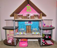 "DIY Barbie House - from small entertainment stand WOW cool idea, plus it would make a great doll house for any doll, you can make all sorts of furniture and stuff or it!! Hmmmmm what about in the back yard for a ""fairy house""????"