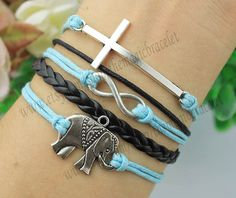 Elephant charm bracelet infinity and the cross by themagicbracelet, $4.99