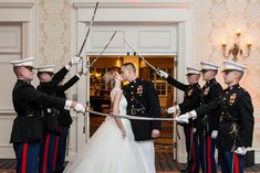 The bride and groom – a United States Marine Corps Captain – entered the reception space through the USMC Arch of Sabers. #WeddingPhotography Photography: Renee Sprink Photography. Read More: http://www.insideweddings.com/weddings/a-blue-white-gold-military-wedding-at-duke-university-chapel/622/