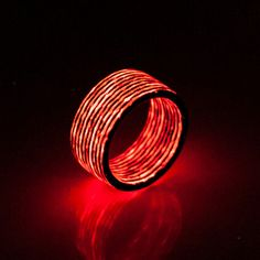 Red-tinted carbon fiber by day, glowing ice white by night. This ring also glows bright red under UV light, for a multi-colored detail that switches from understated to fun and funky in a flash.