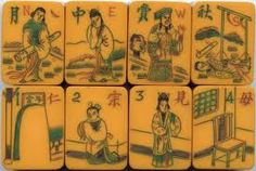 vintage Bakelite Mah Jong tiles.. The bottom line would be better in reverse order. 4,3,2,1. What does the south tile signify?