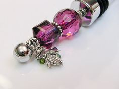 Hey, I found this really awesome Etsy listing at https://www.etsy.com/listing/194925567/purple-themed-beaded-wine-bottle-stopper