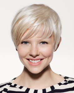 I had hoped that my hair would go completely white as I got older (rather than the uninteresting brown with grey streaks at the front which I have now) so I could have it styled something like this.