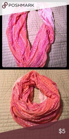 Dainty patterned infinity scarf Light cotton blended delicate patterned infinity scarf.  Pinks and orange colors to this scarf.  Long enough to be wrapped twice. A semi Aztec print to the scarf.  Awesome for spring days for a pop of color. Accessories Scarves & Wraps