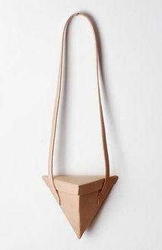 Love-Dart's triangular Giza bag.