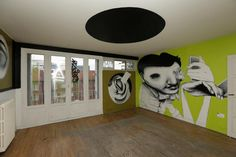 "A living room painted by Brazilian street artist Ethos is seen at the street art project tower ""Paris Tour 13"" in Paris"